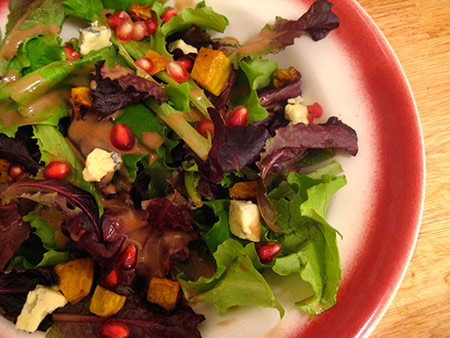 Fall Salad with pomegranate seeds, cashel blue and roasted golden beets